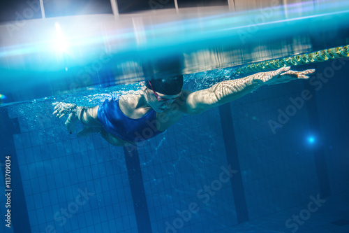 Swimmer woman underwater Fototapeta