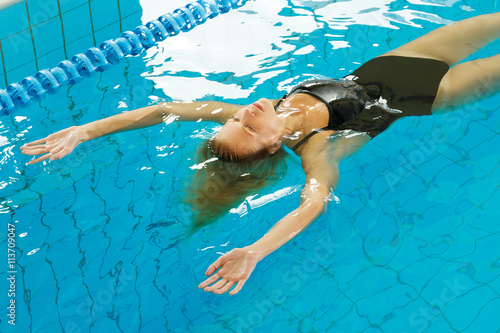 Woman swimming on the back Canvas Print