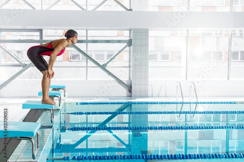 Woman swimmer in a starting position Slika na platnu