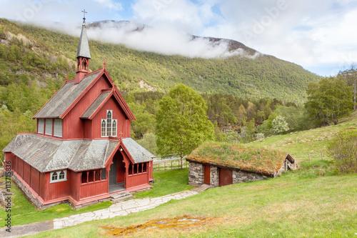 Poster Scandinavië Wooden church amongst mountains - Borgund Kyrkje, Borgund, Norway