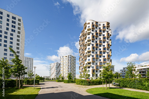 Fototapeta Apartment towers in the city - modern residential buildings with low energy house standard obraz
