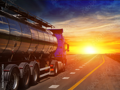 Fotografie, Obraz  Tanker with chrome tanker on the highway. Working visit