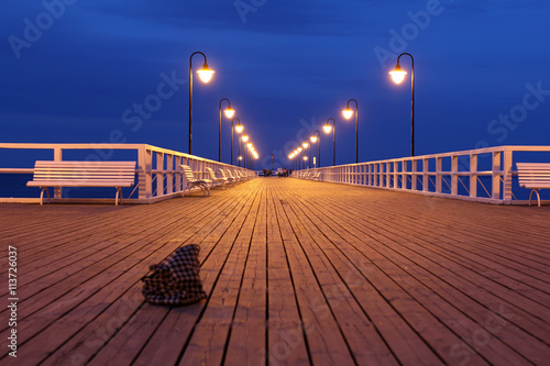 fototapeta na lodówkę wooden pier at night