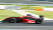 car racing on the road with motion blur and Radial blu