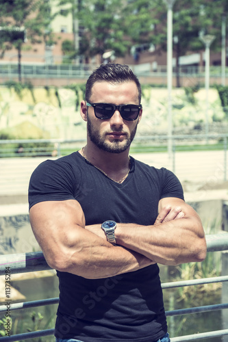 Fotografie, Obraz  Handsome Muscular Hunk Man Outdoor in City Setting