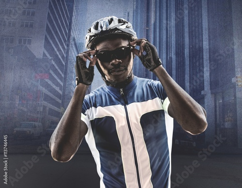 Fotografie, Tablou  Composite image of cyclist is posing