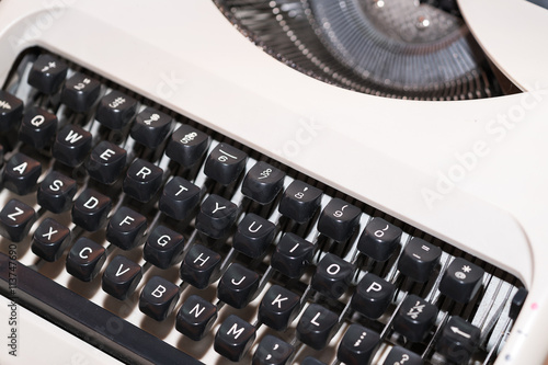 Fototapety, obrazy: Antique Typewriter. Vintage Typewriter Machine Closeup Photo.