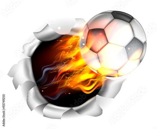 Photo  Flaming Soccer Football Ball Tearing a Hole in the Background