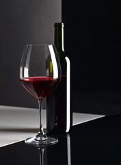 Fototapeta Wino bottle and glass with red wine
