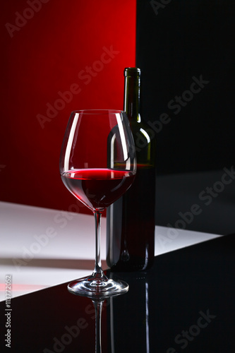 obraz lub plakat bottle and glass with red wine