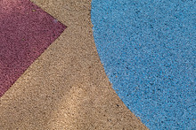 Colorful Red, Yellow And Blue Rubber Wetpour Playground Floor Surface.