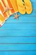 Summer beach objects border, flip flops, copy space, vertical