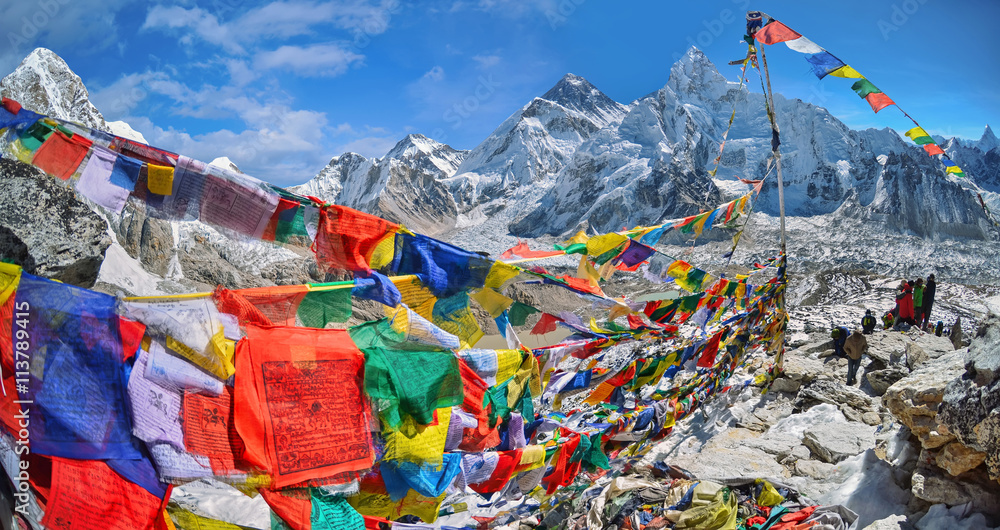 Fototapety, obrazy: View of Mount Everest and Nuptse  with buddhist prayer flags from kala patthar in Sagarmatha National Park in the Nepal Himalaya