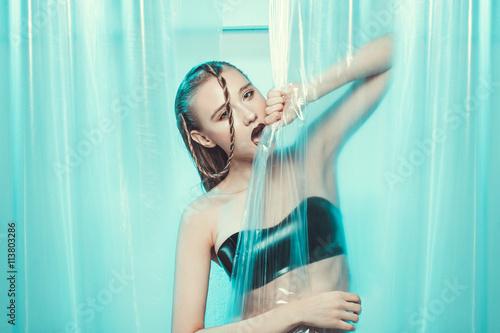 Photo  Girl in latex posing in studio shoot.