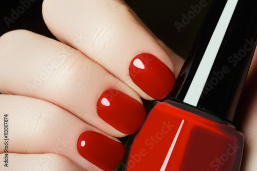 Staande foto Manicure Manicure. Beautiful manicured woman's hands with red nail polish