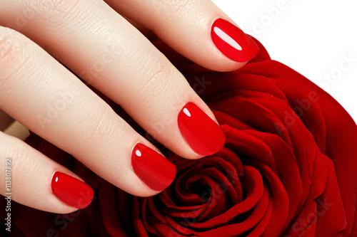 Obraz na płótnie Manicure. Beautiful manicured woman's hands with red nail polish