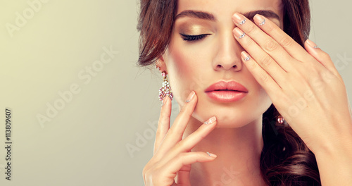 Luxury fashion style, manicure nail , cosmetics and make-up . beige nails with rhinestones .  Beauty , skincare , makeup and cosmetics