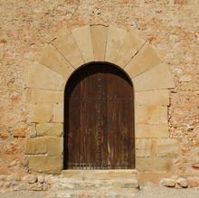 Old Wooden Door In A Stone Facade