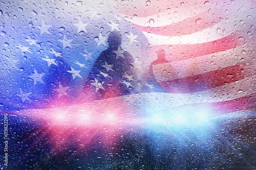 Fotografie, Obraz Police crime scene, rain background with police lights and american flag