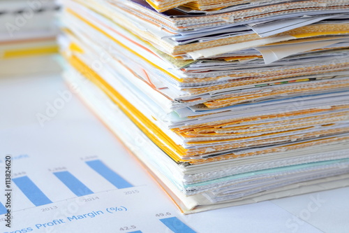 Fotografía  Stack of documents at business office,financial reports and statements,high key tone
