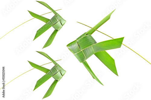 Fotografiet  Thai woven coconut leaves fish on a white background