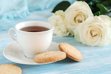 Tea In Elegant Porcelain Cup And Shortbread