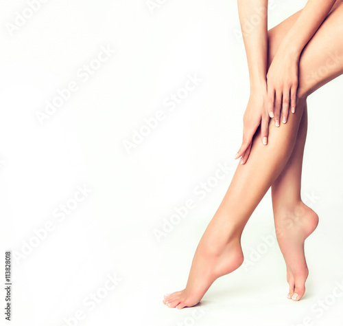 Obraz Beautiful well-groomed female legs . Foot care . Epilation and depilation of hair on the feet .