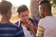 Group Of Teenagers Boy Smoking...