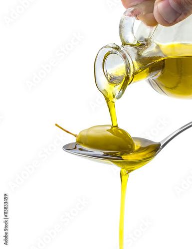 Spoed Fotobehang Aromatische Green olive in full oil spoon on white isolated
