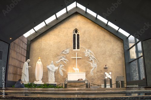 Apparition gable in the Knock shrine, Ireland, with statues of of Our Lady, St J Fototapete