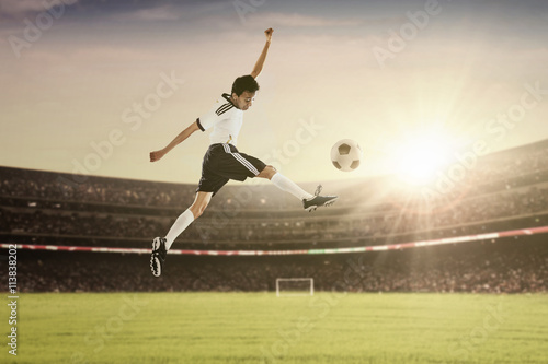 Photo  Soccer player in action kicking the ball