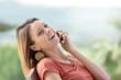 Beautiful woman in garden talking on phone