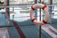 A Red And White Lifebuoy (Kisby Ring) Hanging Near A Covered Swimming Pool In Nahariya