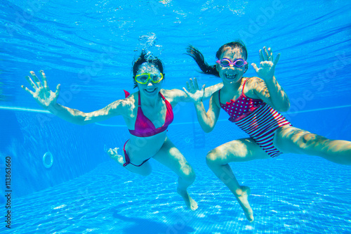 girl with mother playing  underwater Canvas Print