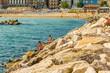 fishermen on rocks in the Adriatic sea