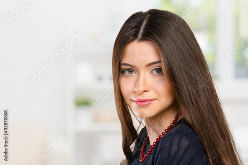 fototapeta na lodówkę Beautiful young woman face closeup