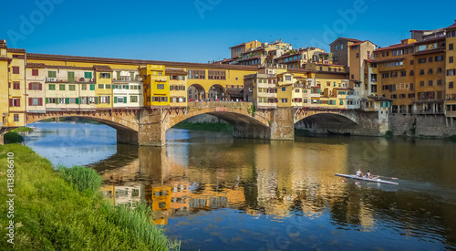 Poster Artistic monument Famous Ponte Vecchio with river Arno at sunset in Florence, Italy