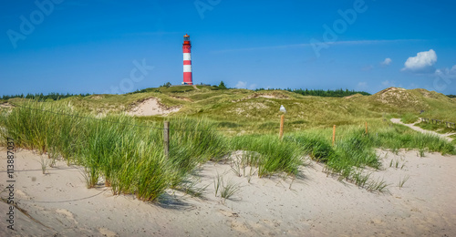 Garden Poster Lighthouse Dune landscape with lighthouse at North Sea