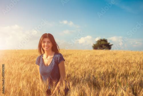 Vászonkép Smiling Woman on Wheat Farm
