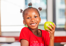 African Girl At School Holding Green Apple Fruit
