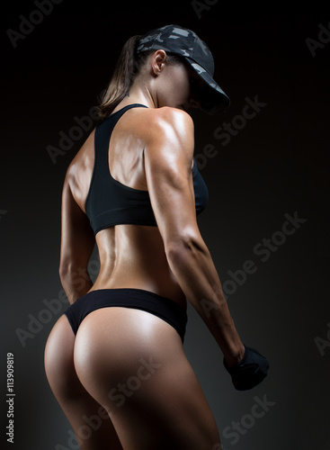 Image of muscular young female athlete wearing hand gloves