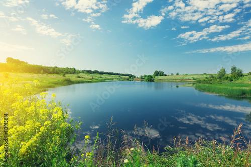 Deurstickers Meer / Vijver Landscape with pond and hills
