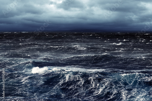 Staande foto Water Stormy Winds Darkening Day and Breaking Waves