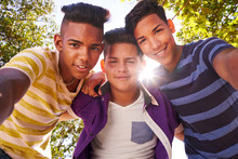 Multiethnic Group Of Teenagers Embracing Smiling At Camera