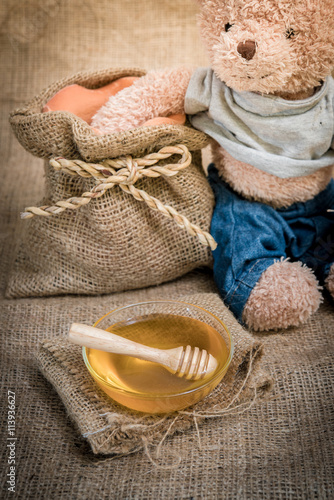 fototapeta na drzwi i meble cup honey on sackcloth