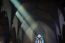 Light Shafts Stream Into Churc...