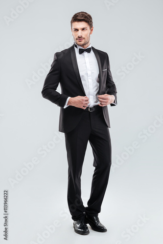 Fotografie, Obraz  Full length of handsome young man in tuxedo with bowtie