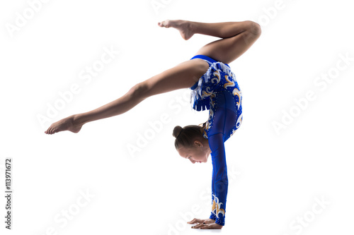 Foto op Canvas Gymnastiek Teenage acrobat girl doing handstand