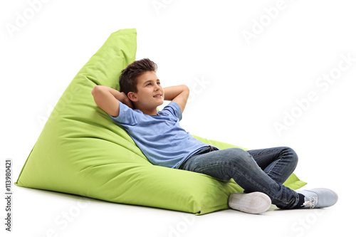 Relaxed boy laying on a beanbag Canvas Print