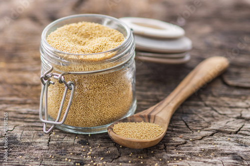 Raw Organic Amaranth Grain on wooden background Canvas Print